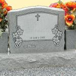 Single Upright Gray Granite -- Serpentine Top -- Sawed Finish -- Matching Base -- Flower and Cross Design Additions